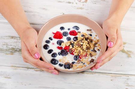 oatmeal: Yogurt with berries, cereals and muesli. Healthy breakfast.