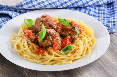 meat food: Pasta with meat, tomato sauce and vegetables. Italian food. Stock Photo