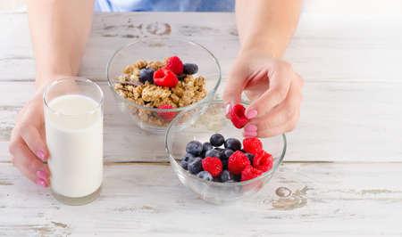 eating fruits: Glass of Yogurt with fresh berries, cereals and muesli. Healthy breakfast. Top view