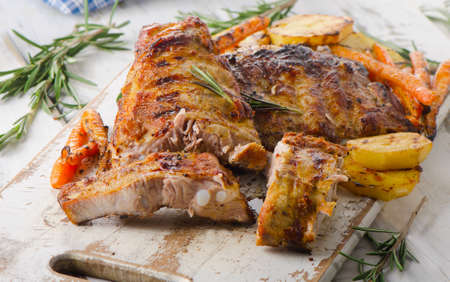 grill: Grilled pork ribs  on wooden cutting board. Selective focus Stock Photo