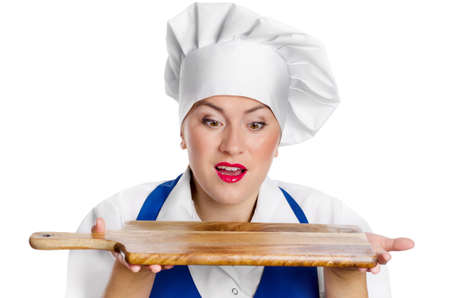 suprise: Portrait of young woman chef with cutting board isolated on a white background