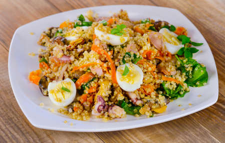 seafood salad: Mixed seafood salad with quinoa and eggs. Selective focus
