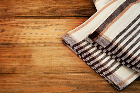 dishcloth: Tablecloth textile on a old rustic background.