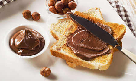 Toast with chocolate spread for a sweet breakfast. Stock Photo