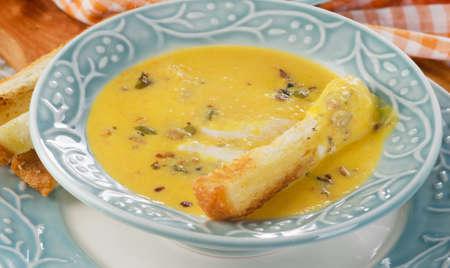 crouton: Bowl of pumpkin soup with a crouton. Selective focus Stock Photo