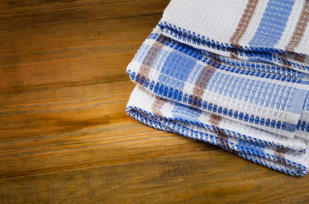 dishcloth: Tablecloth textile on wooden background.