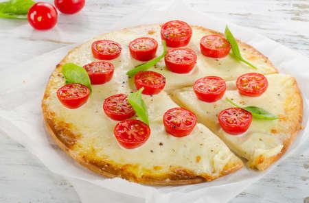 margherita: Italian Pizza Margherita on  wooden table. Stock Photo
