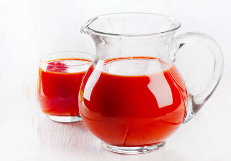 tomato juice: Tomato juice on a wooden table. Selective focus