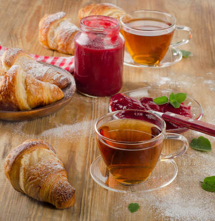 breakfast cup: Cups of tea and croissants for  breakfast. Selective focus Stock Photo