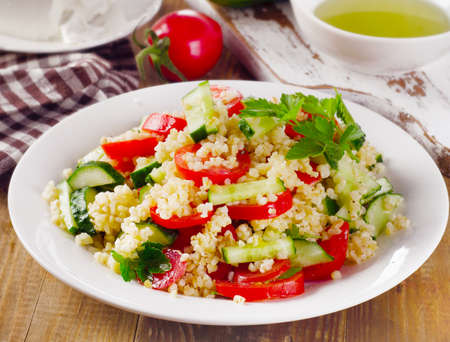 tabbouleh: Tabbouleh salad with bulgur, parsley and vegetables. Selective focus Stock Photo