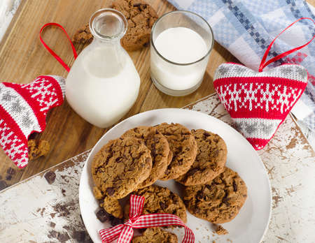 bootle: Chocolate chip cookies with bootle of milk on wooden background. Top view