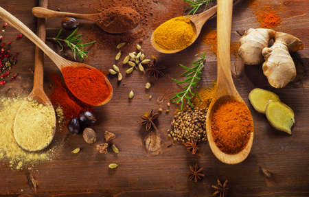 Spices and herbs on wooden background. Top view Banco de Imagens