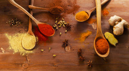 dry powder: Different  spices and herbs on  wooden background. Top view