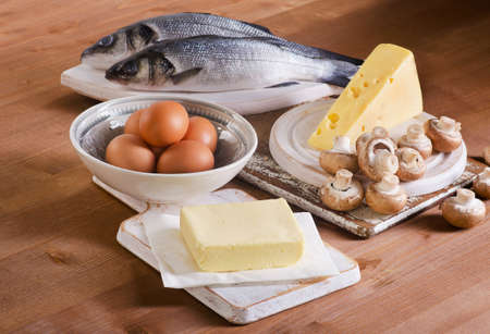 Foods containing vitamin D on a wooden table. Stock Photo