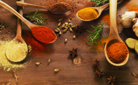 spice: Different  spices and herbs on a wooden background. Top view