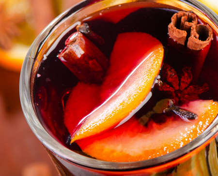punch spice: Mulled wine in a glass. Closeup. View from above