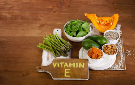 Foods containing vitamin e on wooden board view from above stock foods containing vitamin e on wooden board view from above stock photo 50447785 workwithnaturefo