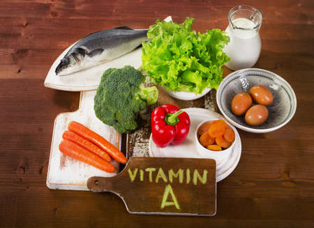Image result for A vitamin food on wooden table