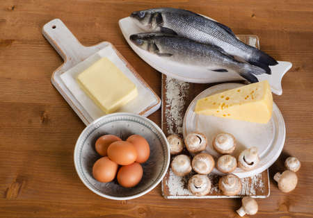 Foods containing vitamin D on wooden table. View from above Stock Photo