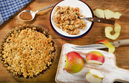 Apple Crumble Dessert on rustic wooden board. Top view