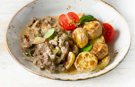 beef stroganoff: Beef stroganoff with roasted potatoes and herbs. Selective focus Stock Photo