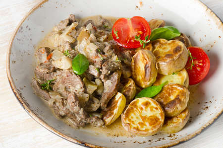beef stroganoff: Beef stroganoff with roasted potatoes. Selective focus Stock Photo