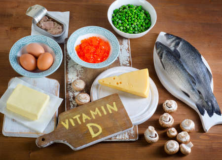 Foods highest in vitamin D on wooden background. Top view Stok Fotoğraf