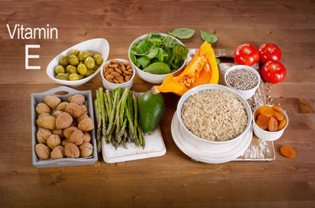 Foods high in vitamin E on a wooden table. Top view Stok Fotoğraf