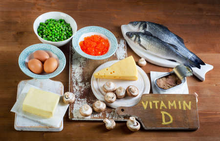 Food sources of vitamin D on a wooden background. Top view Stockfoto