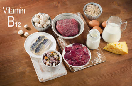 and vitamins: Foods Highest in Vitamin B12 (Cobalamin) on a wooden background. Healthy diet. Stock Photo