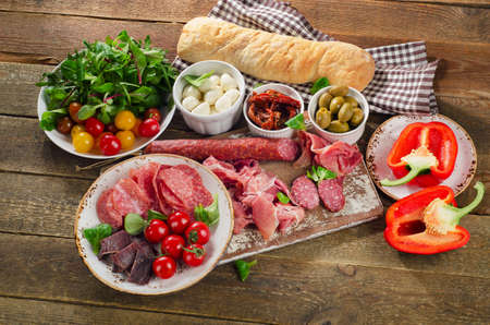 antipasto: Traditional italian antipasto on a wooden board. Top view