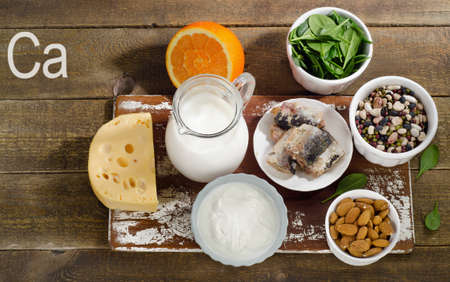 Foods Highest in Calcium on wooden table. Top view