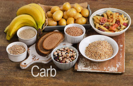 carbohydrate: Foods high in carbohydrate on wooden background. Top view Stock Photo