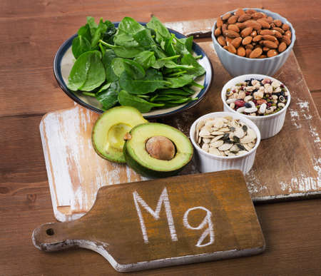 rich: Magnesium Rich Foods on a wooden table.