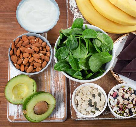 Foods High in Magnesium on wooden table. Top view Banco de Imagens