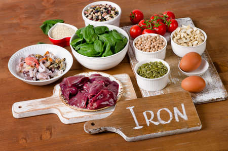 Foods high in Iron, including eggs, nuts, spinach, beans, seafood, liver, sesame, chickpeas, tomatoes.