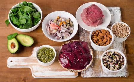 Foods with Zinc on wooden table. Top view Standard-Bild