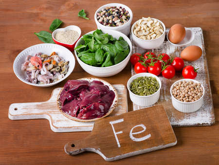 Foods high in Iron, including eggs, nuts, spinach, beans, seafood, liver, chickpeas. Foto de archivo