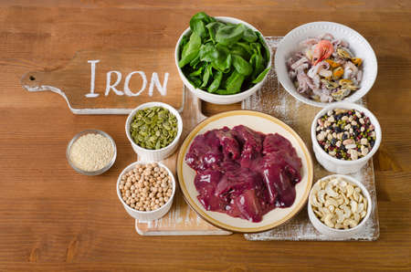 vitamin rich: Foods high in Iron on wooden table. Top view
