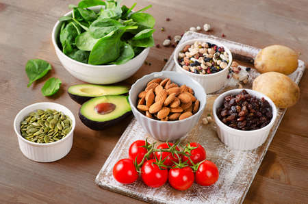 Foods containing potassium on a wooden table.