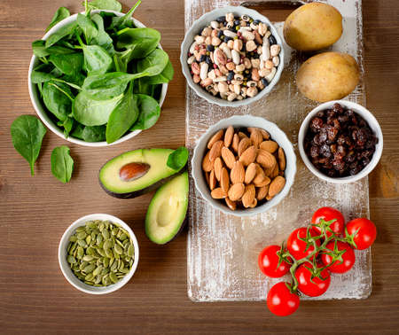 Foods containing potassium on a wooden table. Top view