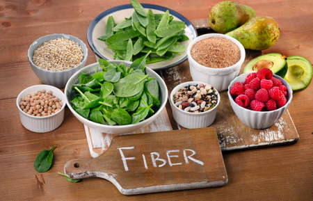 Foods rich in Fiber on a wooden table. Healthy eating. Selective focus