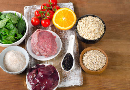 fluorine: Foods High in Fluorine on a wooden background. Healthy eating. Top view Stock Photo