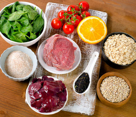 fluorine: Foods High in Fluorine on a wooden table. Healthy eating. Top view