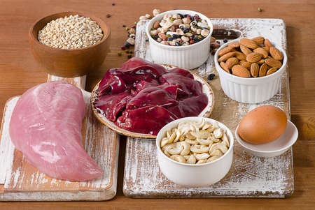 selenium: Foods with Selenium  on a rustic wooden board.