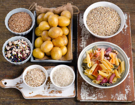 carbs: Healthy Food: Best Sources of Carbs on a wooden background. Top view Stock Photo