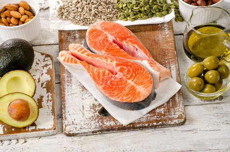 good cholesterol: Healthy Food: Best Sources of healthy fats on a white wooden background.