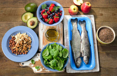 healthy foods: Foods for healthy Heart on a wooden table. Top view Stock Photo