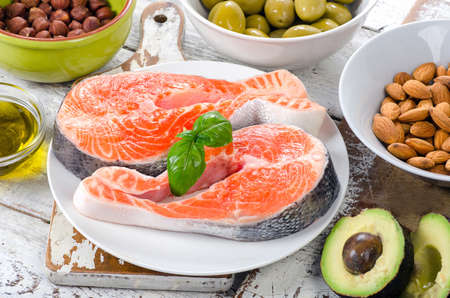 unsaturated: Food sources of unsaturated fats and Omega 3. Healthy Diet eating. Stock Photo