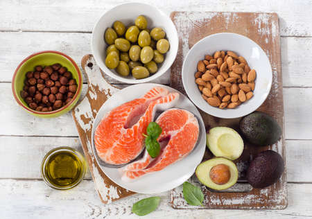 sources: Food sources of  healthy fats. Top view Stock Photo